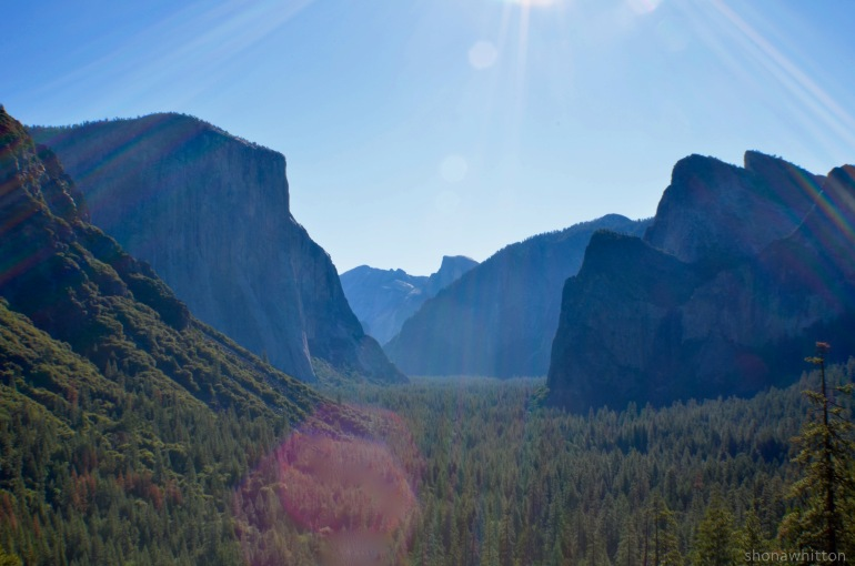 Tunnel View, State Route 41. That's El Capitain on the left, Half Dome on the horizon and if you squint (like I was into the sun) you can see Bridalveil Fall...sort of.